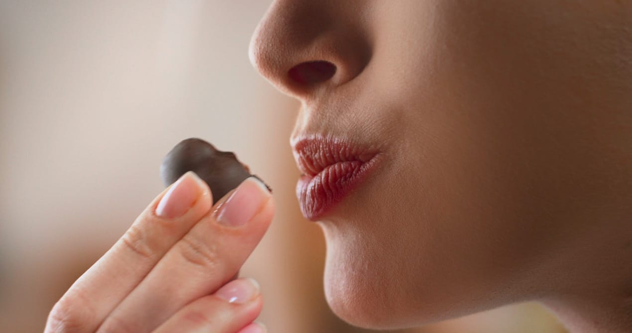 A woman is tasting a Bacio Perugina